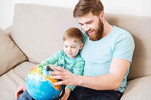 Father with son holding a globe